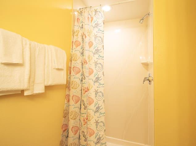 Hallway bathroom with shower