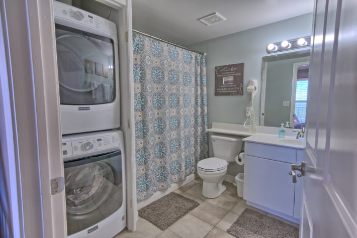 Bunkroom bathroom has a shower/tub combo as well as the washer and dryer.