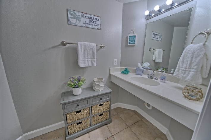 Half bath is located in the hallway and has plenty of storage.