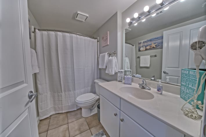 2nd master ensuite bathroom is very spacious with a shower/tub combo.