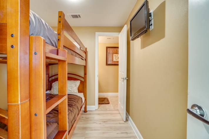 Bunk room,  with bunk beds, TV and half bath