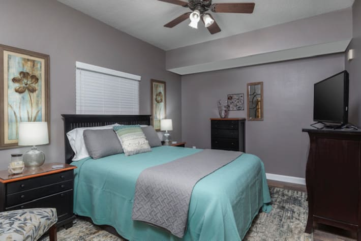 """Guest bedroom has full bed and 54"""" SMART TV."""