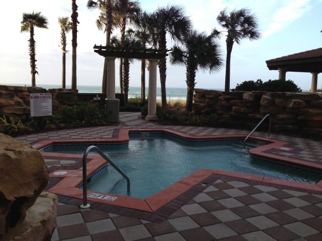 Large Hot Tub on pool deck