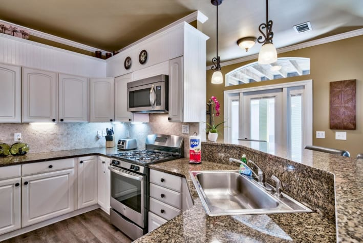 Coconut Cove at Emerald Shores - Kitchen Featuring Stainless Steel Appliances