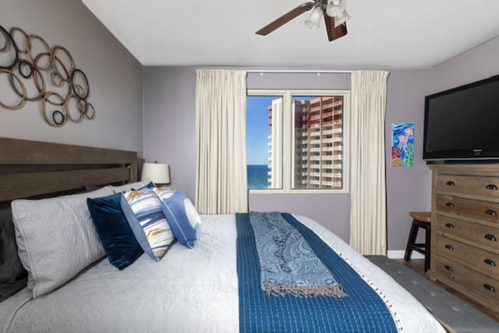 """Primary bedroom has 54"""" LED TV and a beautiful ocean view!"""