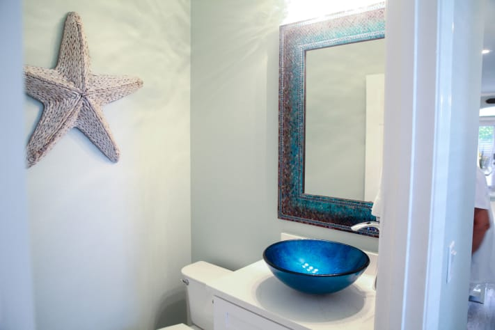 Powder room with vessel sink on main level