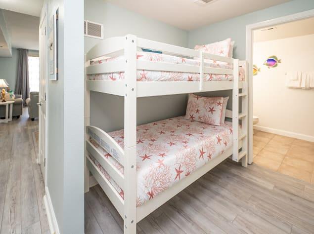 Twin bunk nook with hallway bathroom