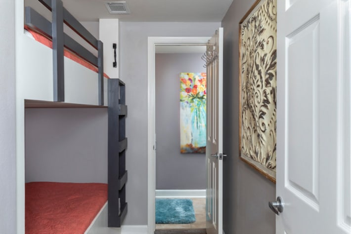Bunk room with attached half bath and privacy door.