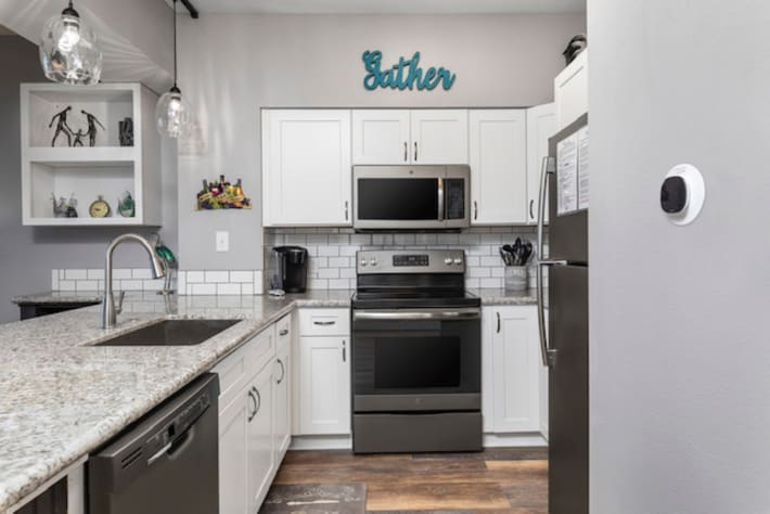 Completely updated kitchen with stainless steel appliances and new cabinets.