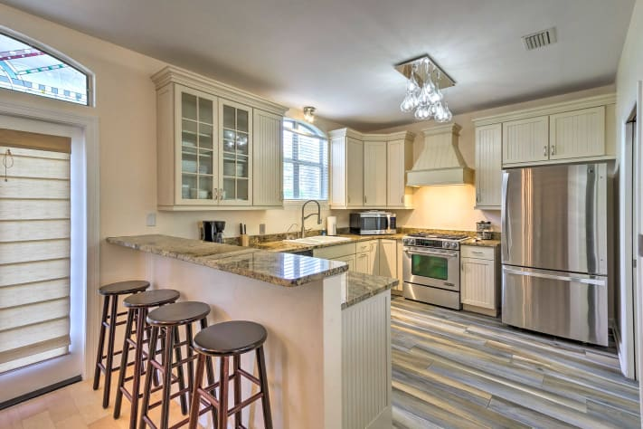 Gourmet kitchen with stainless steel, gas range and oven with convection option.