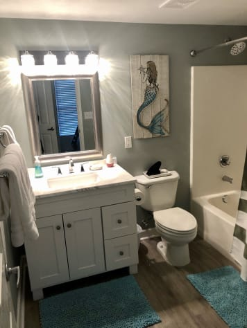 Beautiful Bath with new Vanity, Lighting, Faucets & Flooring.