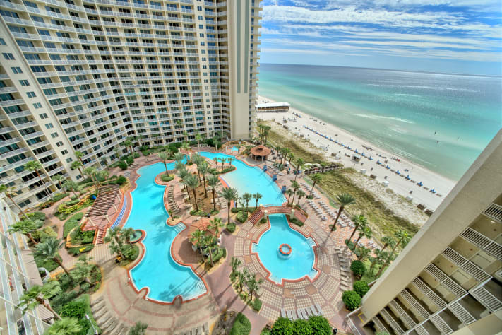 View of the lagoon style pool and the Gulf of Mexico from the balcony.