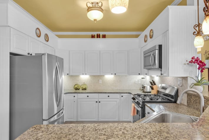 Coconut Cove - Kitchen Featuring Stainless Steel Appliances