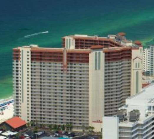 The Shores of Panama Resort can be identified by its horizontal red stripe on the 20-23rd floors.