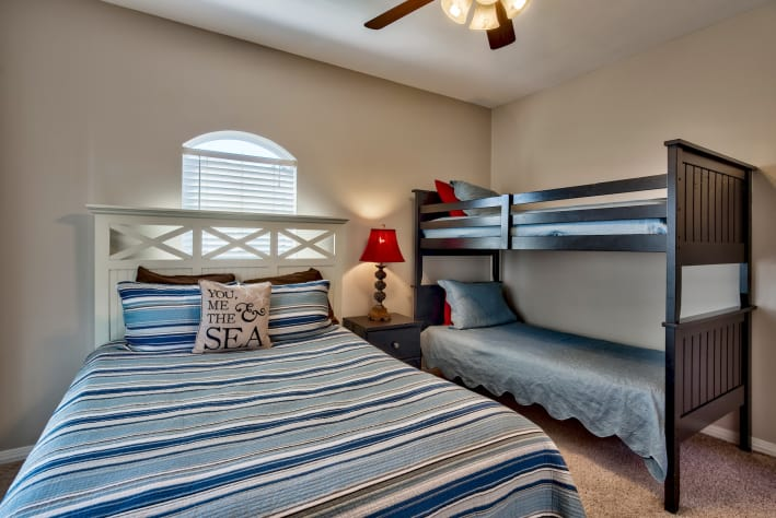 Second Floor Queen bedroom with twin over twin bunk beds and Balcony Access
