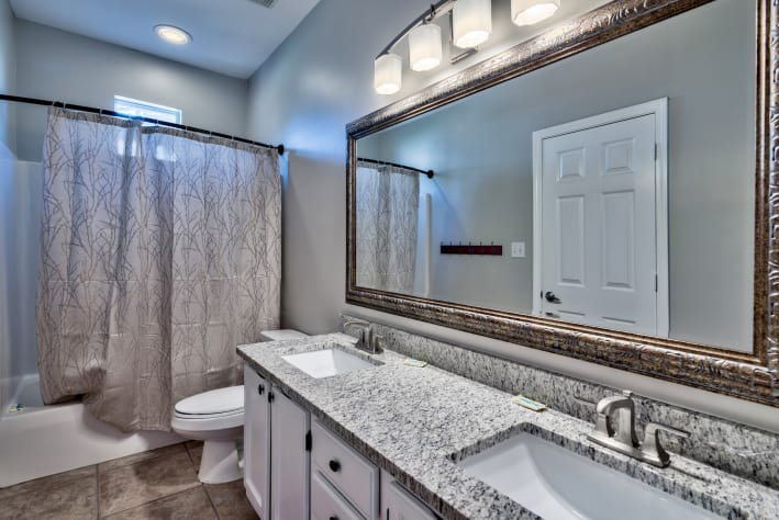 First Floor Shared Full Bath with Double Vanity and Tub/Shower Combo