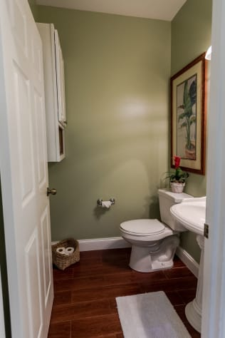 Convenient first floor half bath with pedistal sink