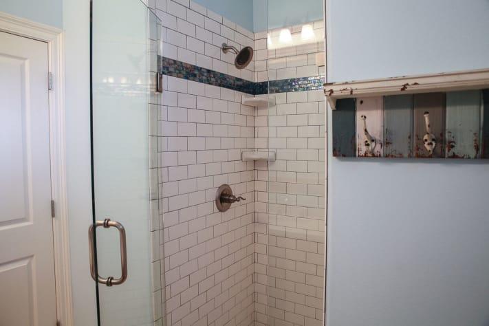 Newly tiled subway shower on main level