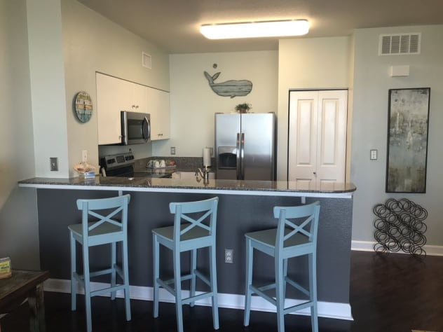 Additional seating, barstools at the kitchen counter