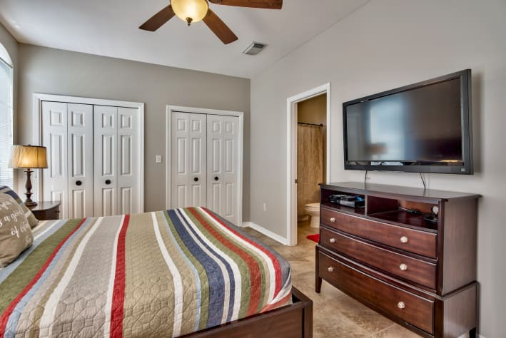Additional View of First Floor King Bedroom with En Suite Bath with Patio Access