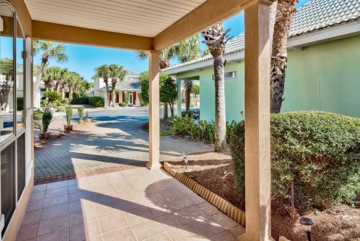 Front porch and driveway with 2 car parking. Overflow parking at either pool.