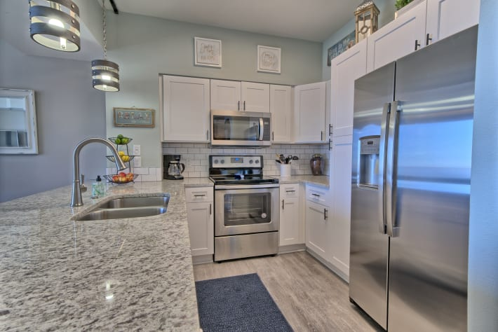 New stainless steel appliances and fully stocked kitchen.