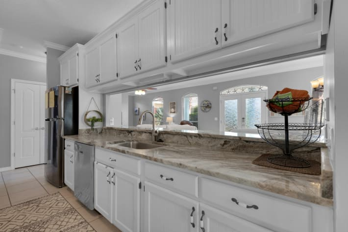 Kitchen features granite counters and stainless steel appliances
