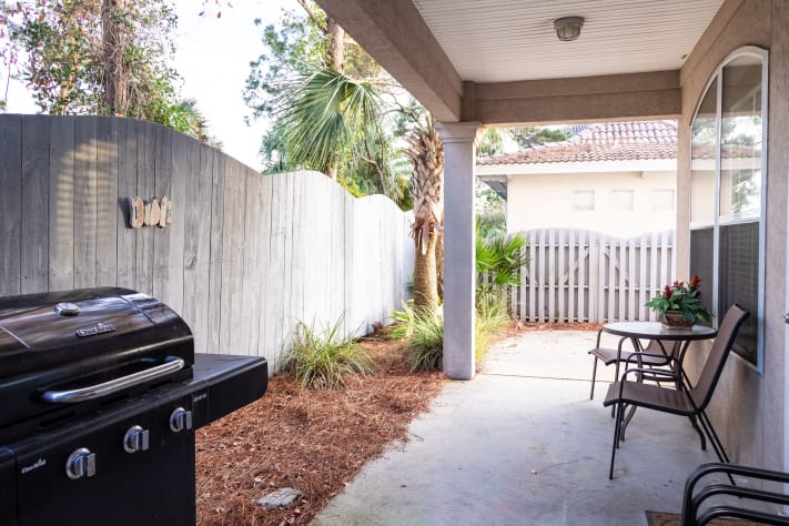 Back porch with propane grill, free propane, closet with wagon and beach toys