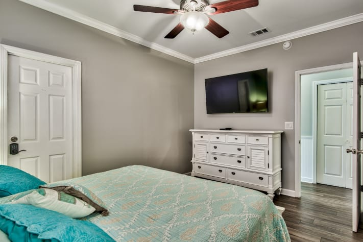 Master Bedroom with King bed, Smart TV, and en suite