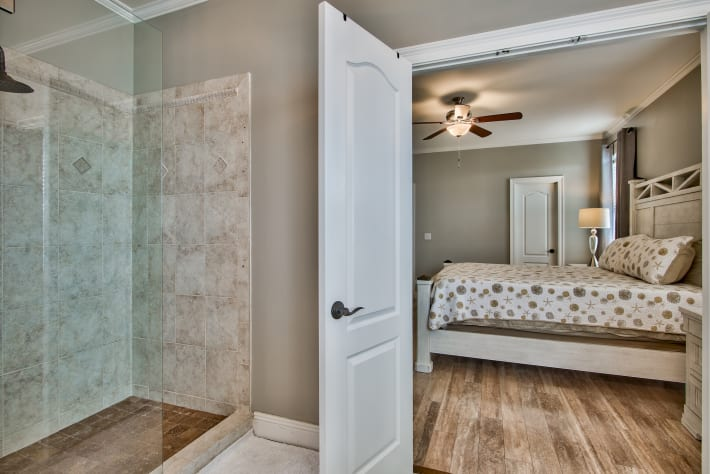 Master attached bathroom with large tub/shower
