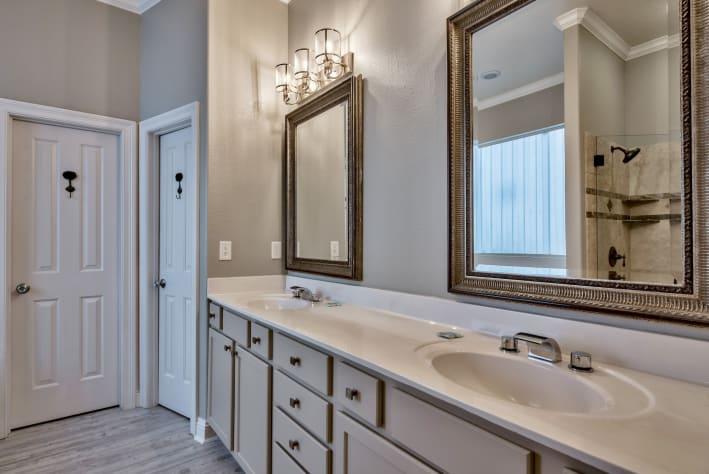 En suite 1st floor bathroom with walk-in shower & Jacuzzi tub and twin vanities