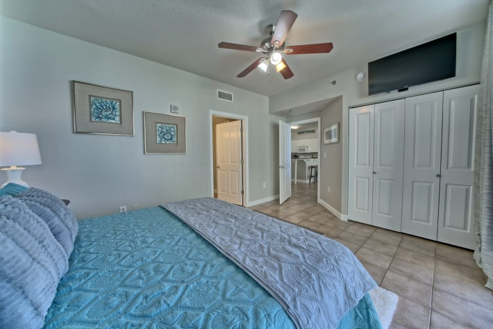 Very spacious master bedroom with a new TV and lots of storage.