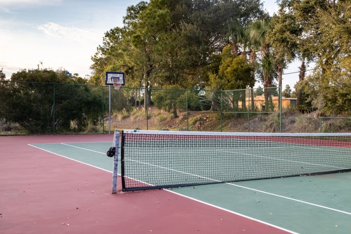 Tennis court and basketball hoop close to the home for you to enjoy