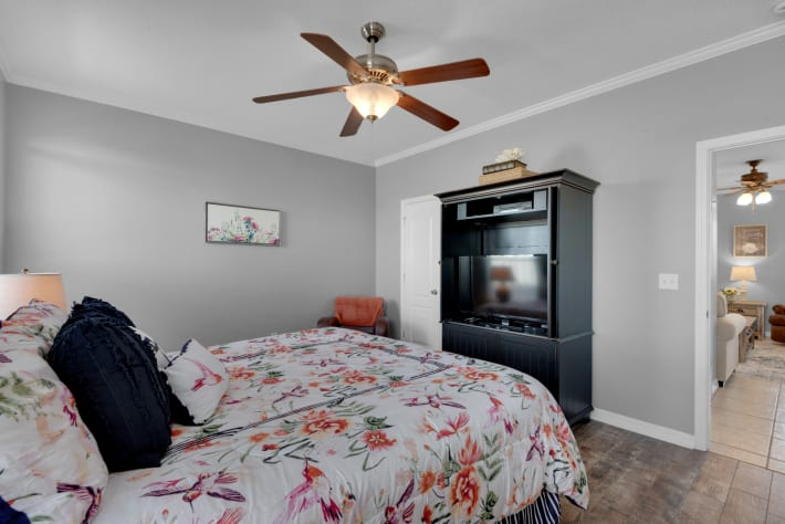 First floor Master features large flat screen tv plus walk in closet