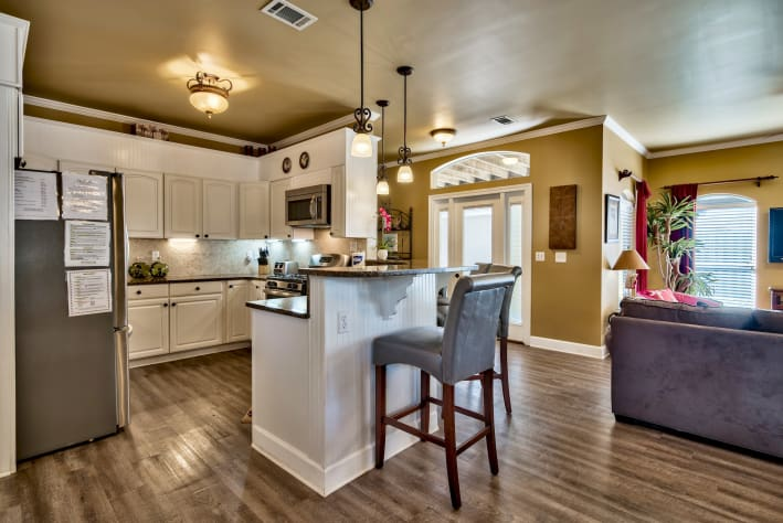 Kitchen with granite breakfast bar and stainless appliances