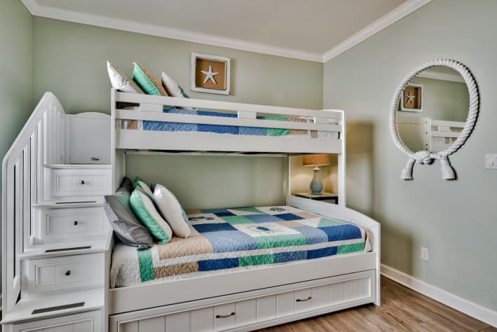 3rd Guest Bedroom: 1 bunkbed with twin on top/full bed on bottom, twin trundle bed and attached Full Jack-N-Jill Bathroom (sleeps 4)