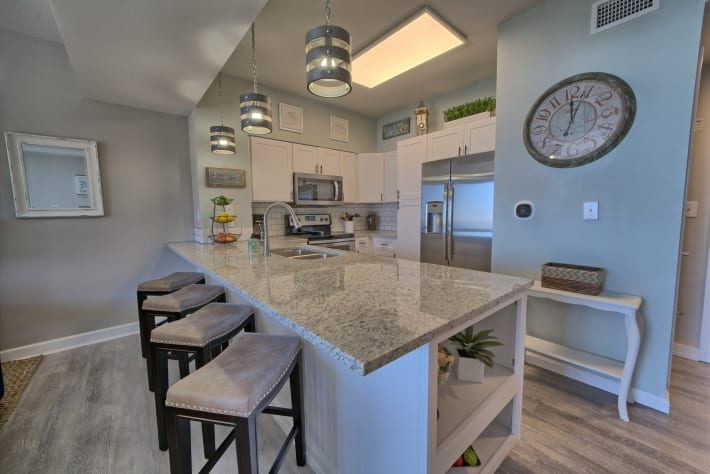 Beautiful updated kitchen with a countertop bar for dining.