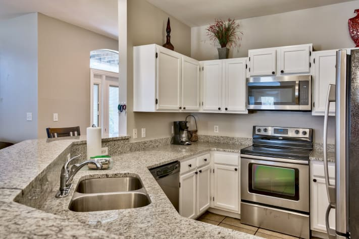 Additional View of Fully Stocked Kitchen with Breakfast Bar
