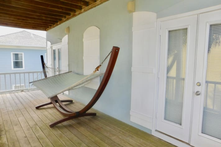 Second Floor Covered Porch with Hammock Accessible from Both Second Floor Rooms