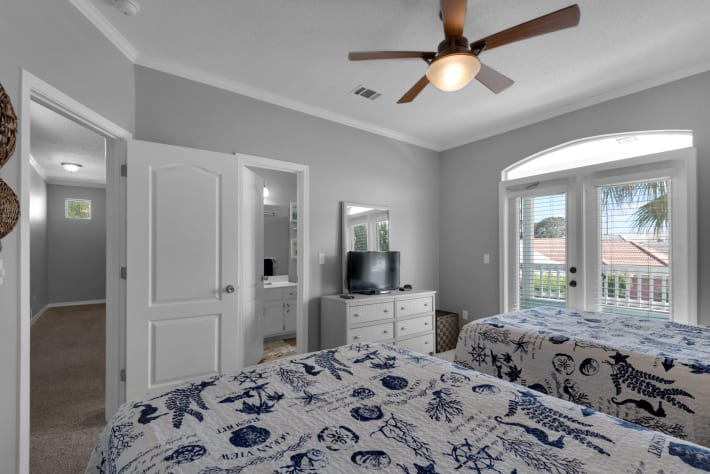 The guest bedroom has flat screen tv, access to balcony and guest bath