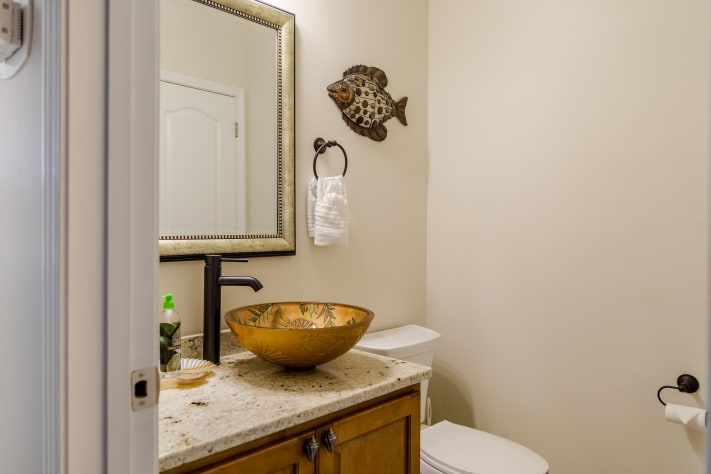 Convenient first floor half bath with updated granite and vessel sink