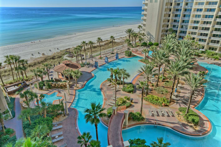 View of the lagoon style pool and the Gulf of Mexico!