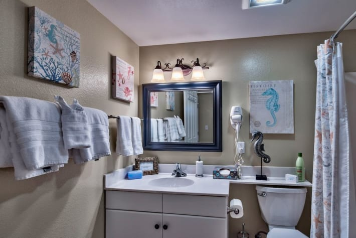 En Suite bathroom off of second bedroom. New full size front loading washer/dryer. Includes hair dryer.