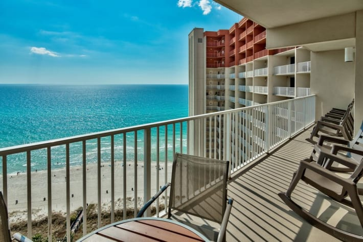 Enjoy Gulf views from these comfortable & relaxing rocking chairs.