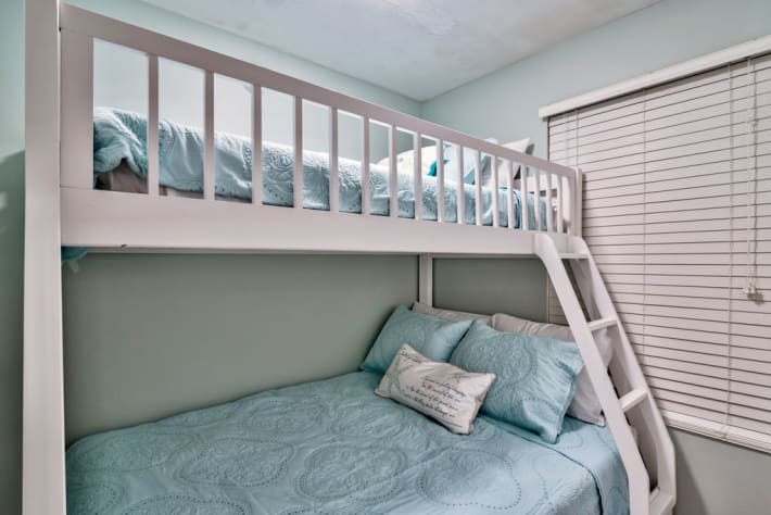 Bunk room has door for privacy, twin on top and full on bottom