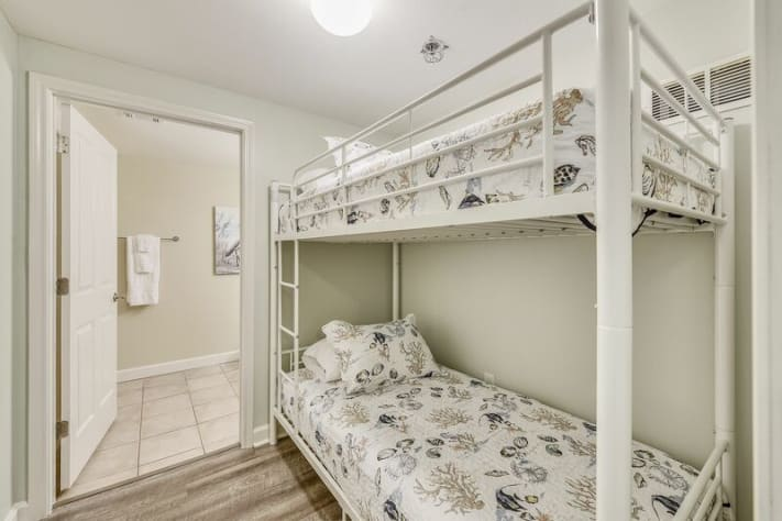 Twin bunk beds are in a nook area great for kids to sleep