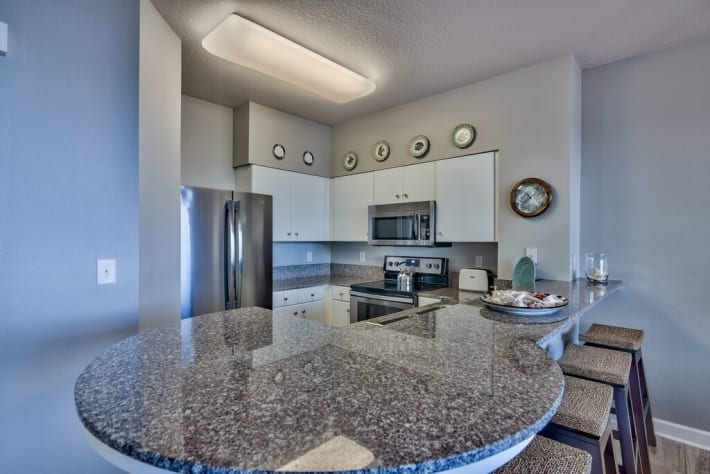 Granite counters, white cabinets and stainless appliances
