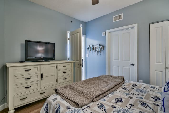 Flat screen TV and ample storage in Guest Room