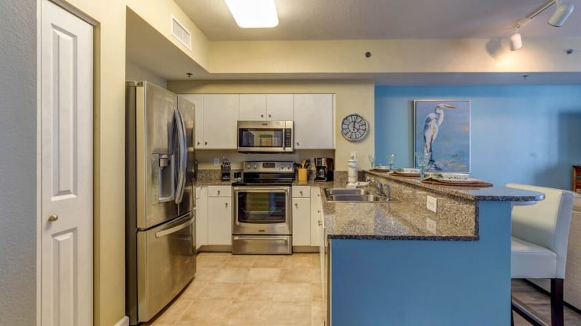 Granite counters, stainless steel applinces and fully stocked kitchen!