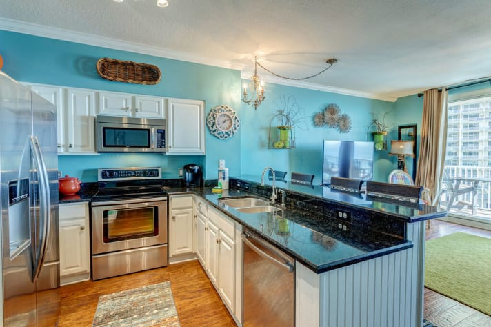 Granite counters, stainless steel appliances and a fully stocked kitchen!